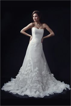 sophi paulette gown and sophie skirt from the heidi elnora fall 2014 collection #projectrunway #straplessgown #weddingchicks http://www.weddingchicks.com/2013/12/23/heidi-elnora-fall-2014-collection/