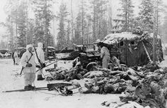 Dead Bodies After Battle in Finland Original caption: Piles of corpses in the snow after a battle at Syskyjarvi in Finland, at which most of the 18th Soviet Russian division of at least 18.000 men was slain.