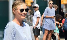 Maria Sharapova wears sporty mini-dress and trainers in New York