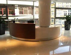 Bespoke reception desk using high gloss HPL and veneer