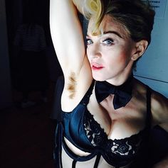 Madonna sports hairy underarms. Society says its wrong for women to have hairy under arms. Though this was not always the case...