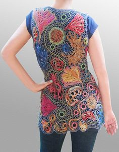 This is actually a mash-up of knit, crochet and embroidery freeform. I used size 1 needles for some of the motifs as well. Motifs were made and connected with an Irish Crochet filling. by laigeez, via Flickr