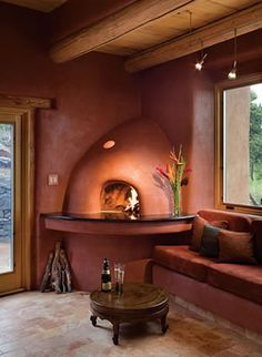 Inspiration for the pizza oven in the corner of my kitchen... really like the rounded ledge in front of the kiva in this picture.