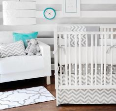 Love the Gray and white chevron bedding for baby boy and then instead of blue, use orange throws and orange accents to make it pop!