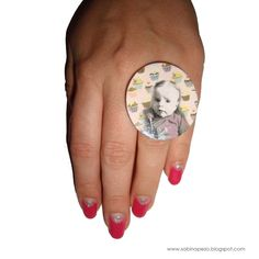 A ring, fimo and decoupage. This was a gift for a friend. The little boy on the ring is her son :)