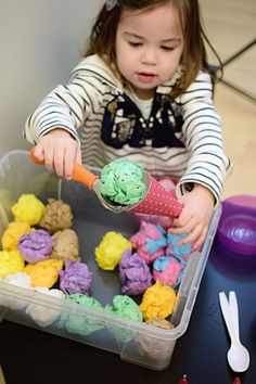Little girl scooping a light green tissue paper ball representing mint chocolate chip ice cream into a red cone for an ice cream parlor dramatic play activity set up with tissue paper balls representing ice cream in a clear plastic bin Toddler Fun, Toddler Crafts, Learning Activities, Preschool Activities, Preschool Cooking, Dramatic Play Area, Dramatic Play Centers, Preschool Dramatic Play, Ice Cream Theme