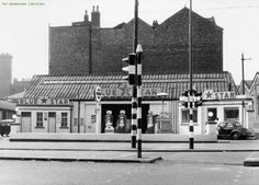 The Blue Star Garage.Corner of Oldham Road and Thompson Street 1960s.