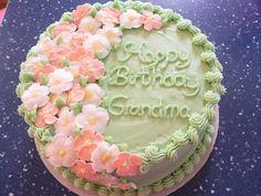 littleredhencakes.com  Sweet and beautiful birthday cake for Grandma. I love this one!