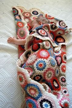 I love this unique pattern crochet baby blanket. The baby blanket just simply looks adorable in this colorful yarn combination. And I love the wave pattern where it reminds me of a rainbow promises (waves) over your baby! Beau Crochet, Knit Or Crochet, Baby Blanket Crochet, Crochet Stitches, Crochet Patterns, Blanket Patterns, Hexagon Crochet, Crochet Blankets, Hexagon Pattern