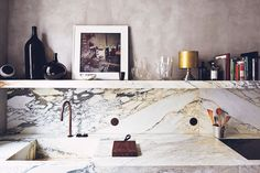 Gorgeous marble kitchen in a Paris apartment, spotted on This Is Glamorous.
