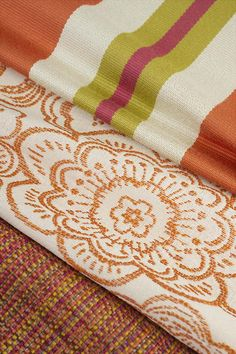 Fabricut's Color Studio IV - Tangerine collection.  Image credits (top to bottom): Nya Stripe – Tangerine, Laguna – Melon and Wiz Texture – Fiesta.