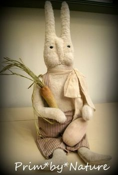 Primitive Bunny Rabbit with carrot and brown easter egg
