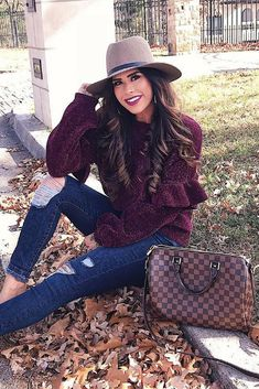 My chenille, ruffled sweater is under $50 and I am ALL ab this color for the holiday season! Find all the outfit details. Blue distressed jeans, ruffled burgundy sweater, hat, long hair, animal print shoes, fall outfit, fall fashion, fashion blogger, #ootd #fallfashion #winteroutfit #emilyanngemma #Thesweetestthingblog Emily Ann Gemma, The Sweetest Thing Blog.