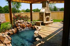 Outdoor fireplace with patio, pool, garden and gazebo