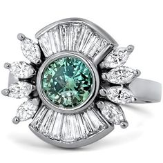 The Dorothea Ring from Brilliant Earth The center stone is an intense green diamond - a green diamond, wow!