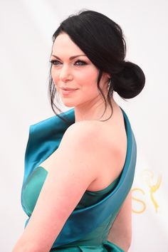 Laura Prepon's romantic low bun and luminous skin were the perfect complement to her structured Gustavo Cadile gown. // #Emmys2014