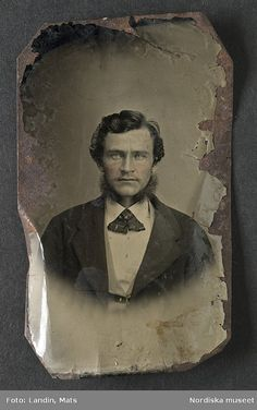 "T is for TINTYPE - ""Portrait of a man with sideburns, wearing a black jacket and…"