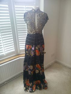 Check out this item in my Etsy shop https://www.etsy.com/uk/listing/291972045/maxi-dress-made-with-vintage-fabric