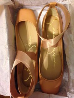 Jessica Simpson// flats made to look like pointe shoes.  I always wanted to take ballet when I was little but we couldn't afford it.  Now I can pretend!