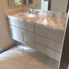 Almost there....just need a little hardware, styling and good photography. #penny tile #floatingvanity #scottsdaleinteriordesign #arcadiabluedesign #marble #redfieldhouse