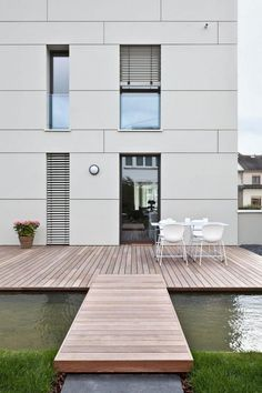 Home design, Terrace House With Outdoor Dining With Wooden Floor Plan Surrounded By Pond: modern white house color exterior with fish pond wooden deck
