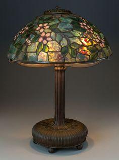 TIFFANY STUDIOS LEADED GLASS AND BRONZE APPLE BLOSSOM TABLE LAMP, circa 1910.