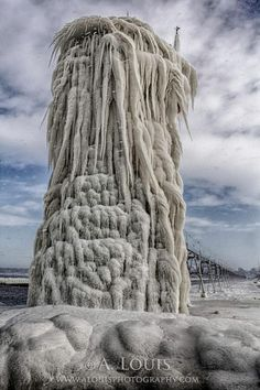 Incredible ice formations on a frozen lighthouse in South Haven by Anthony Pietrzykowski