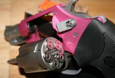 Pink and chrome Taurus 38. snub nose.... Don't Hate These Beeotches !! They'll blow your sack off !!