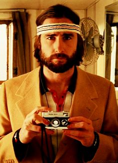 Luke Wilson as Richie Tenenbaum, The Royal Tenenbaums (2001), with a Rollei 35S