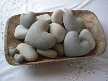 heart shaped rocks mixed in with regular rocks. Subtle, yet interesting.