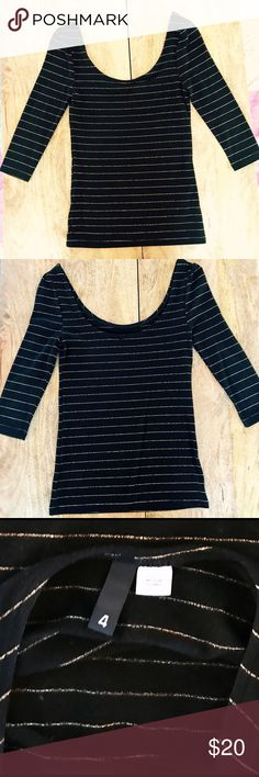 H&M Scoop Neck and Back Top with Gold Stripes Black comfy stretchy 3/4 sleeve top with thin gold stripes through out.  Flattering scoop neck front and back just show off the décolletage! Super sexy. EUC H&M Tops