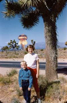 Literaly the first photobomb in history.--Me: It's just a palm tree on fire.