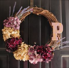18 inch grapevine wreath with hydrangea in shades of purple and gold, hand painted letter of choice. via Etsy.