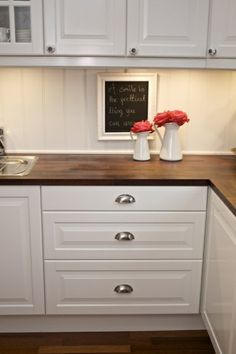 Love the dark butcher block with white cabinets and the draw pulls! Hate the knobs on doors. Butcher block counter tops with beadboard background @ DIY House Remodel Wooden Countertops, Butcher Block Countertops, Butcher Blocks, Dark Counters, White Laminate Countertops, Inexpensive Kitchen Countertops, Stone Countertops, Kitchen Redo, New Kitchen