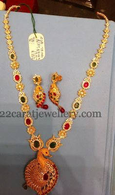 CZ Set with Dancing Peacock Locket | Jewellery Designs