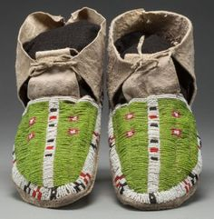PAIR OF SIOUX BEADED HIDE MOCCASINS.