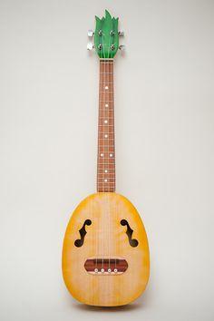 Pineapple ukulele  (relief carved sides and back). $700.00, via Etsy.