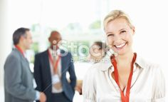 Confident business woman with colleagues in background Royalty Free Stock Photo