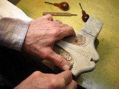 Bob Benedetto handcarves the rear of headstock on the 45th Anniversary Cremona April 2011