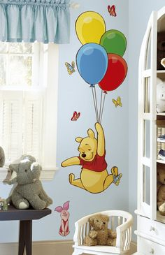 Adorable decor idea for a gender neutral Winnie the Pooh themed baby nursery.