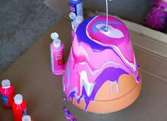 Really cool idea for painting flower pots! I don't know what kind of paint it is but it's definitely a must try project