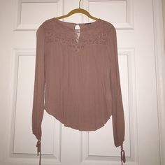 Blouse from Charlotte Russe Size M blouse from Charlotte Russe. Blush color, worn twice. Long sleeved, with ties at the end. Matching this top with a skirt or jeans is super easy. I love the design on top, it's fun yet classy. Charlotte Russe Tops Blouses