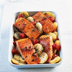 This Mediterranean salmon recipe is served with roasted potatoes, cherry tomatoes and capers.
