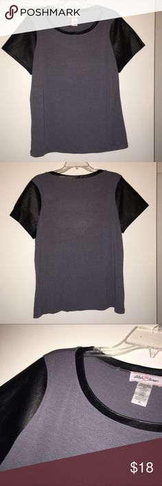 """Faux leather sleeve tee-NEW! Stylish gray tee shirt with faux leather shirt sleeves and piping around neck. BRAND NEW NO TAGS. 77% polyester, 19% rayon, 4% spandex. 24"""" long to hem. Stitch Btween Tops Tees - Short Sleeve"""