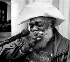"Grandpa Elliott - is a street-musician in New Orleans, Louisiana. He plays the harmonica, sings, and is a street icon in New Orleans. He has been featured on Playing for Change in several episodes. His debut song with Playing for Change was ""Stand by Me""."