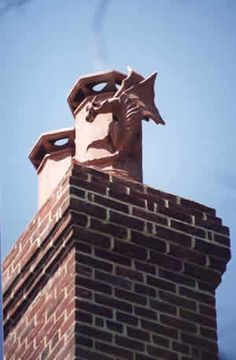 Chimney pot with a little dragon.