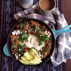 Brunch bake: baked eggs in chipotle sweet potato and brown rice with cilantro, red onion, avocado…