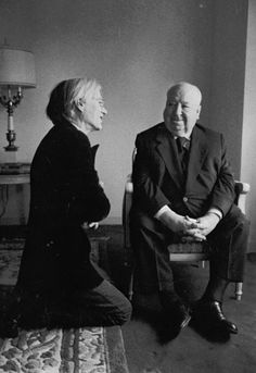 Hitchcock and Warhol. Discussing their mutual love of blondes, I assume.