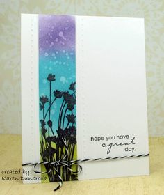 To create my card, I first masked the panel and stamped my Penny Black Hillflowers in black and embossed.  Next I rubbed on Distress inks in various colours and dropped some water for interest.  Since the Distress inks are water based, adding the drops leaves a small watermark behind.  Next I scored both sides with a ScorPal and then with my Scor-bug and added my sentiment.