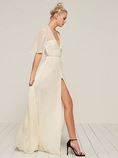 Ask yourself if marriage is right for you. This is a floor length, wrap dress with a low v neckline and high slit.